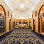 Elegant and impressive lobby with historical exhibits including ship's bell from SS San Francisc