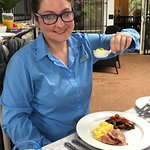 Ashley eating a delicious breakfast at the Plumbago
