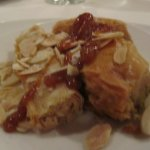 Three pieces of Baklava, each made with a different nut in them