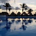 Bahia sunrise over pool, looking out towards the beach
