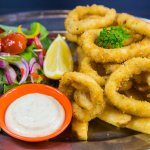 Calamari Dinner come with yummy calamari and our famous beer battered chips and your choice of s