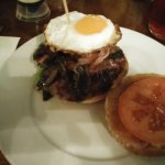 Burger with bacon, egg and tomato
