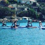 Paddleboard yoga in Milna bay, island Vis