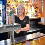 An extensive bar with a terrific selection of local craft beer on tap