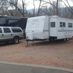 My Travel Trailer and SUV with Pike's Peak in the background