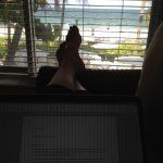 Working on my laptop in a pool deck room - ones on the end have an extra window w/beach view.