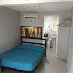 Single bed with private shower and toilet