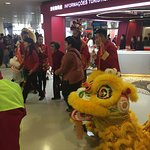 Lion dancers posing with visitors