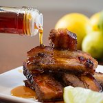 Crispy pork belly with Salute's signature Pomegranate Chili Lime Drizzle. Yum!