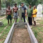 Crew that cleaned up the grave