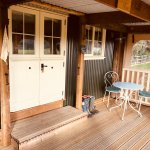 Lazy Day's Shepherds Hut - Private veranda with fairy lights.