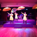 The entertainments crew doing their thing ' Singing in the rain'