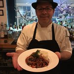 Executive Chef Burgess with the seared duck.