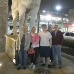 The Lemanski Family in front of the statues at PF Chang entrance.