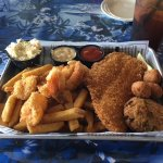 The Seafood Lover's (fried shrimp, fish filet, spicy crab cake, fries, hush puppies, slaw)