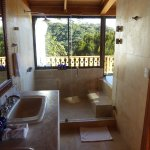 The Sunrise room bathroom with unusable cold spa in the bedroom