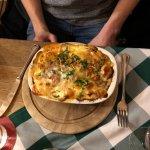 Curry wurst in potato gratin