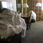 Empty beer cans & sheets in my room upon check in