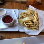 White Truffle Pomme Frites: Crispy Shoe-string Potatoes • Cracked Pepper • Parmesan • Truffle Oi