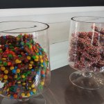 Chocolate covered pretzels sitting pretty in jars.