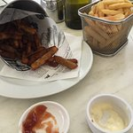 bucket of kumara fries with aioli and tomato sauce and normal fries