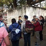 The group on the walking tour hearing about what living on the street is like.
