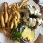 Chicken tender sandwich with avocado and fries