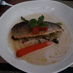 Slow roasted Seabass with olives, tomatoes, potatoes & Artichoke hearts