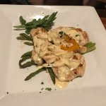 Chicken Oscar, breast topped with lump crab meat and hollandaise sauce