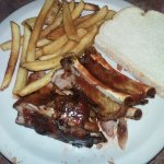Ribs, a side of fries and bread that comes with the ribs