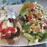 Traditional gyro with Greek salad, fresh and tasty! You can't go wrong!
