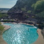 one of the many beautiful pools and sun decks nestled in the rocks of the Butte
