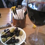 A glass of wine and a few olives prior to Dinner at the old quay house