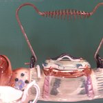 Ceramic Sausage dog teapot; survived the 1931 earthquake. I want one!