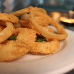 Hand sliced and breaded onion rings.  Never frozen!
