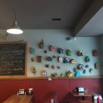 Collection of bird houses on the restaurant wall