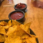 Chips and Salsa, far one is spicy close one is a mild sauce