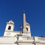 The Church of Trinita dei Monti and Obelisco Sallustiano towers over Piazza di Spagna