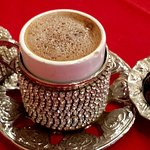 Turkish coffee pretty and tasty...served with chocolate covered coffee beans.