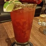 Caesrar drink with dill pickle and pepperoni