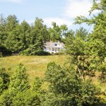The Carl Sandburg home occupies a pleasant spot on a hill overlooking a small pond.