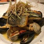 the branzino over white beans and shellfish