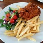 Chicken schnitzel, chips & salad