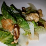 a very nice romaine hearts with roasted pine nuts and romano