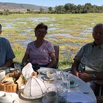 My aunt, uncle and father enjoying lunch with the swamp behind them.
