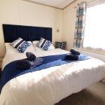 Sublime Hot Tub Caravan at Oakdene Forest Park - The Master bedroom