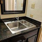 Kitchen sink is your vanity sink, too.