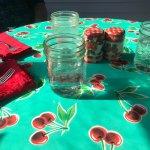 Mason jars, cloth napkins on colorful table tops.