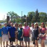 Tour group posing in front of the iconic Hudson Arch.