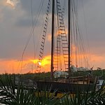 View of sunset and pirate ship from the deck of the Catch Restaurant in Grand Cayman, 2/15/18
